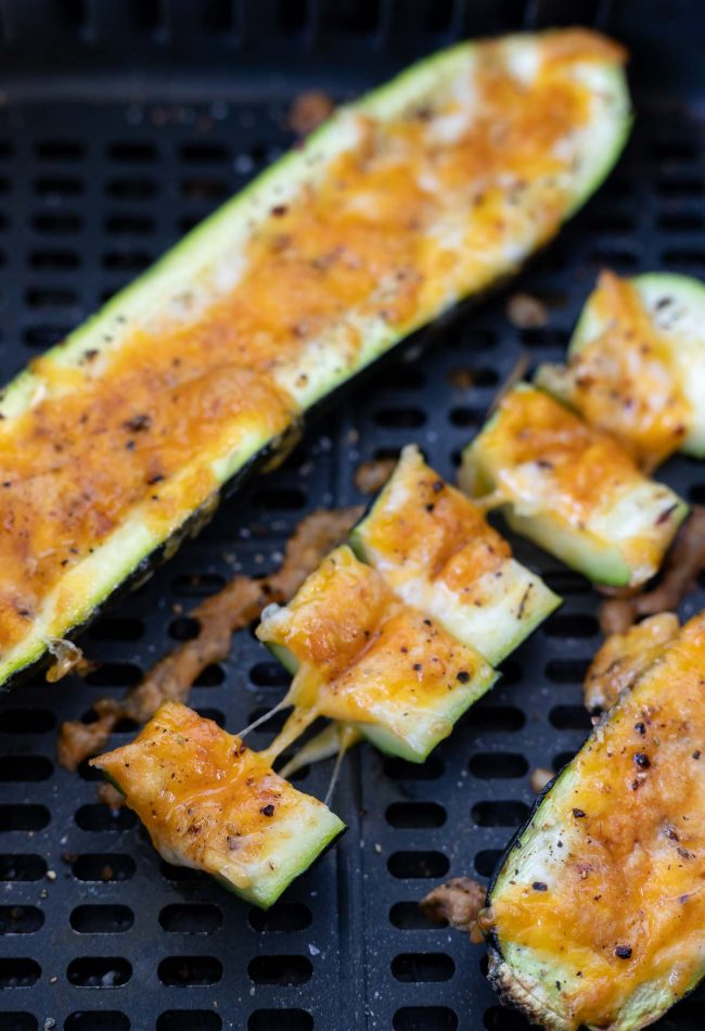 cooked cheese stuffed zucchini in air fryer basket