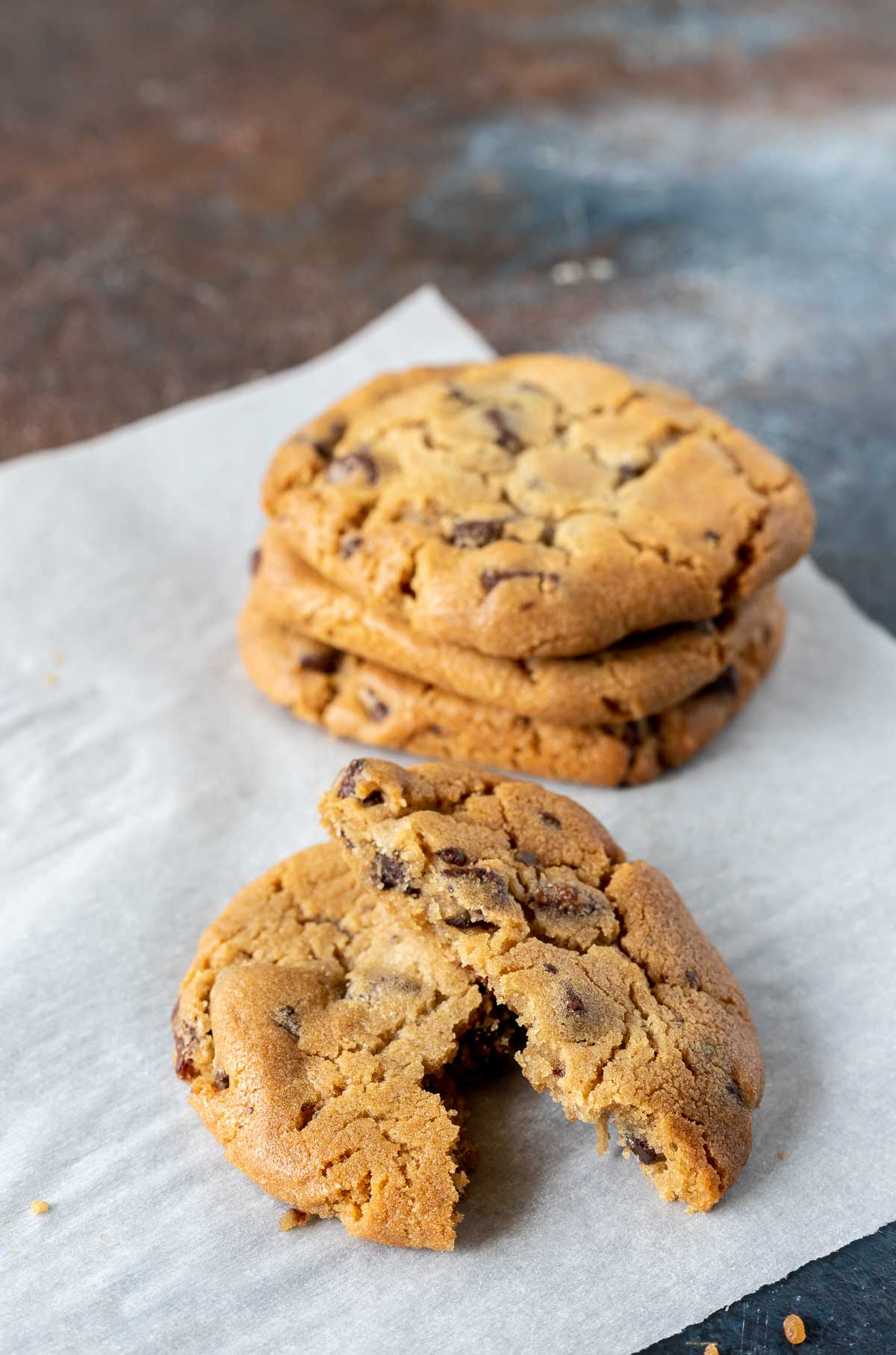 baked chocolate chip cookies on parchment paper
