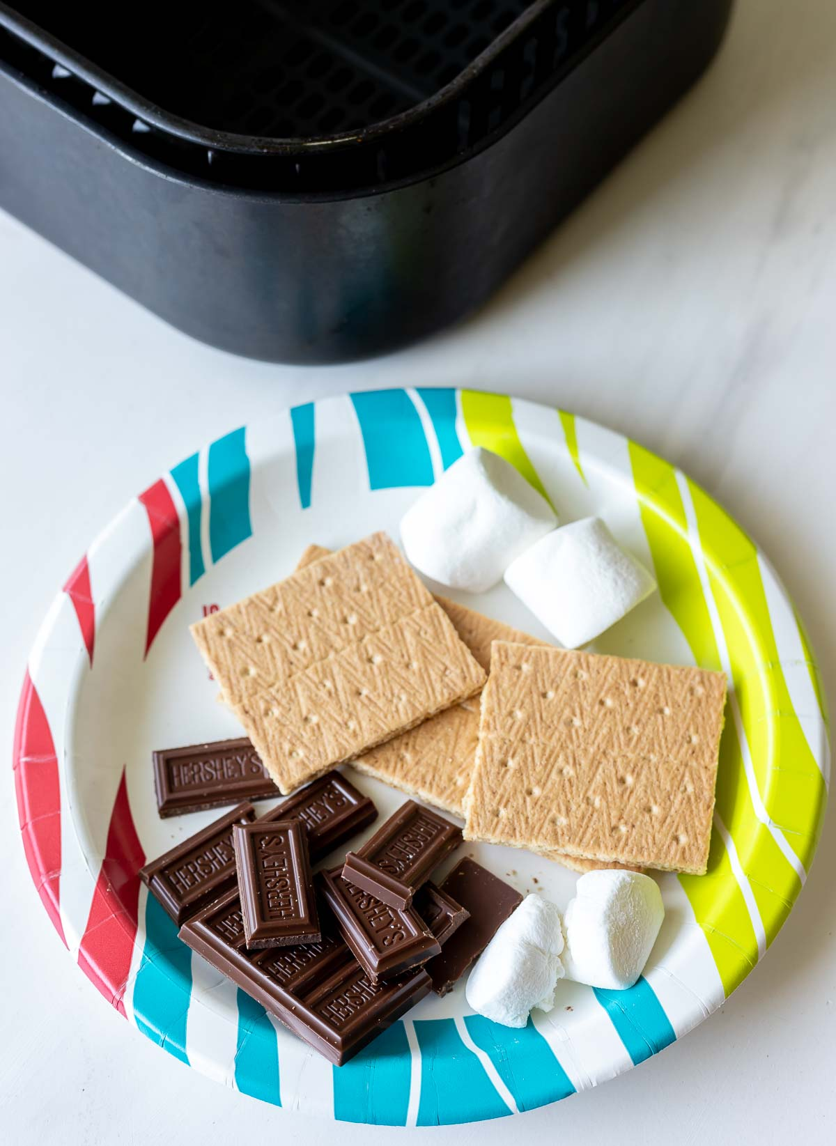 smores ingredients on paper plate