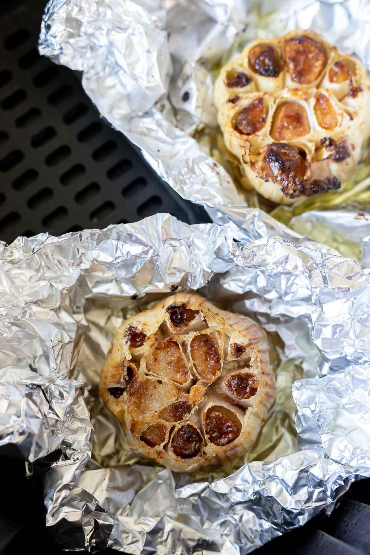 roasted garlic on foil in air fryer basket