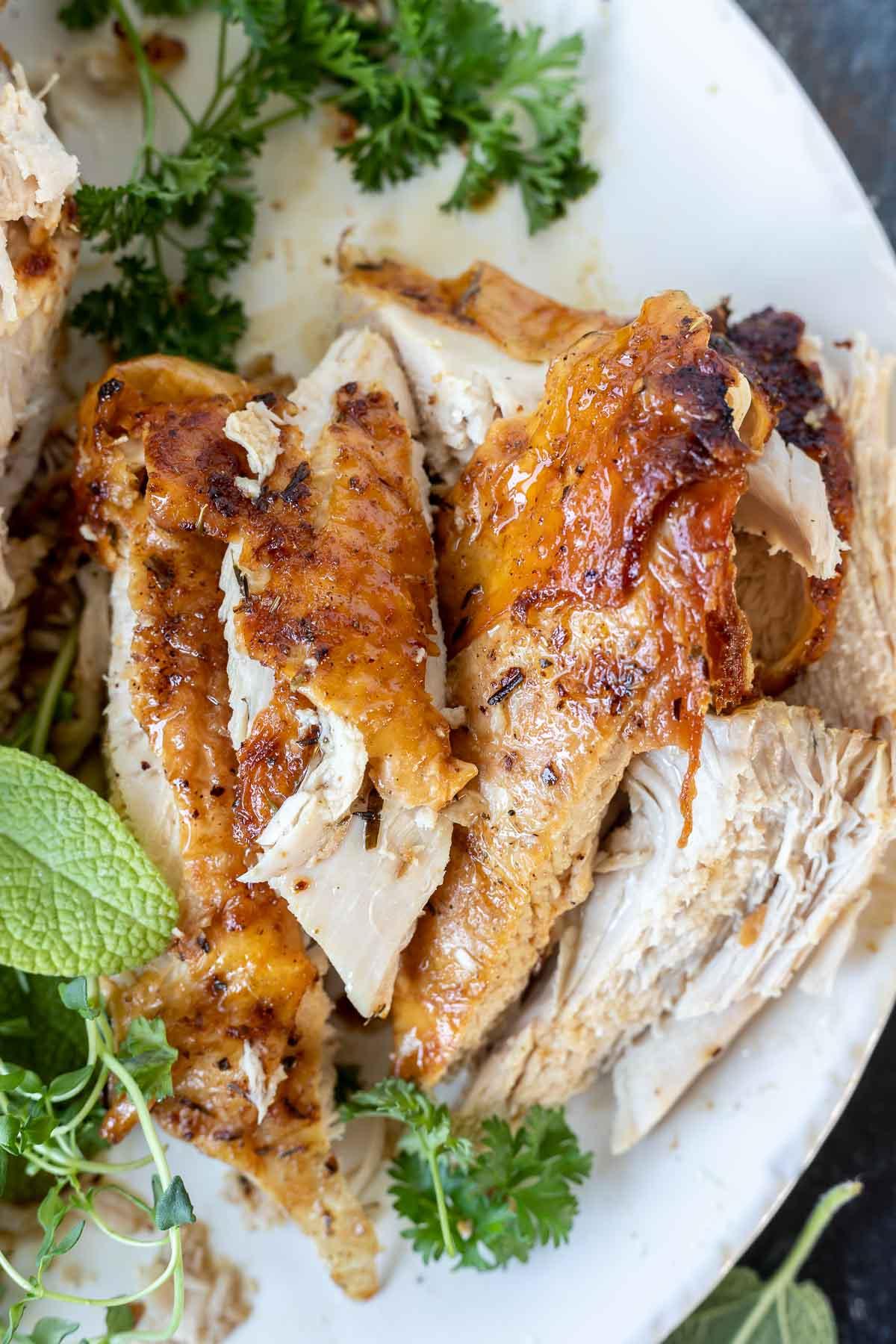 slices of turkey breast on white platter