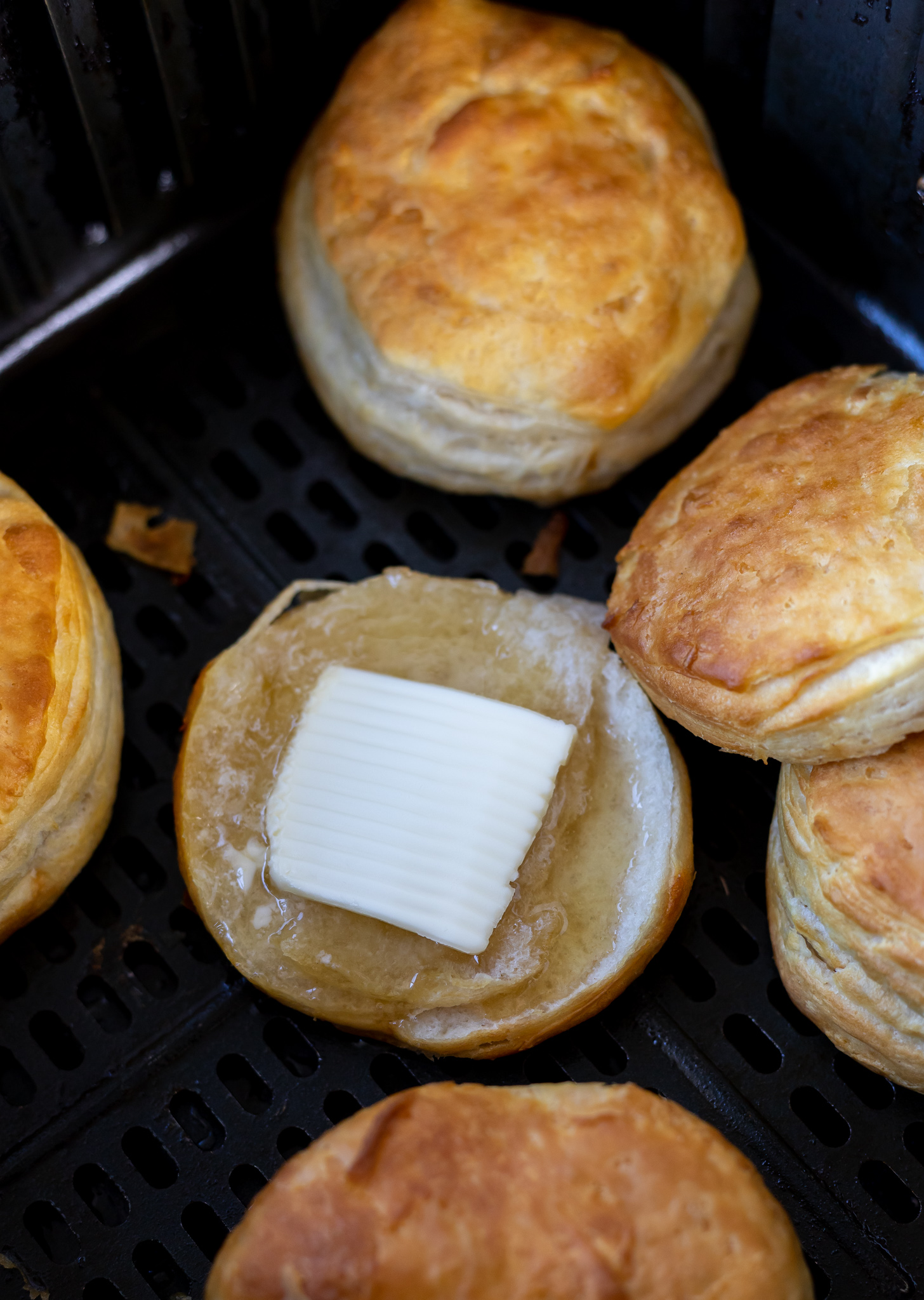 biscuit cut in half topped with butter and honey