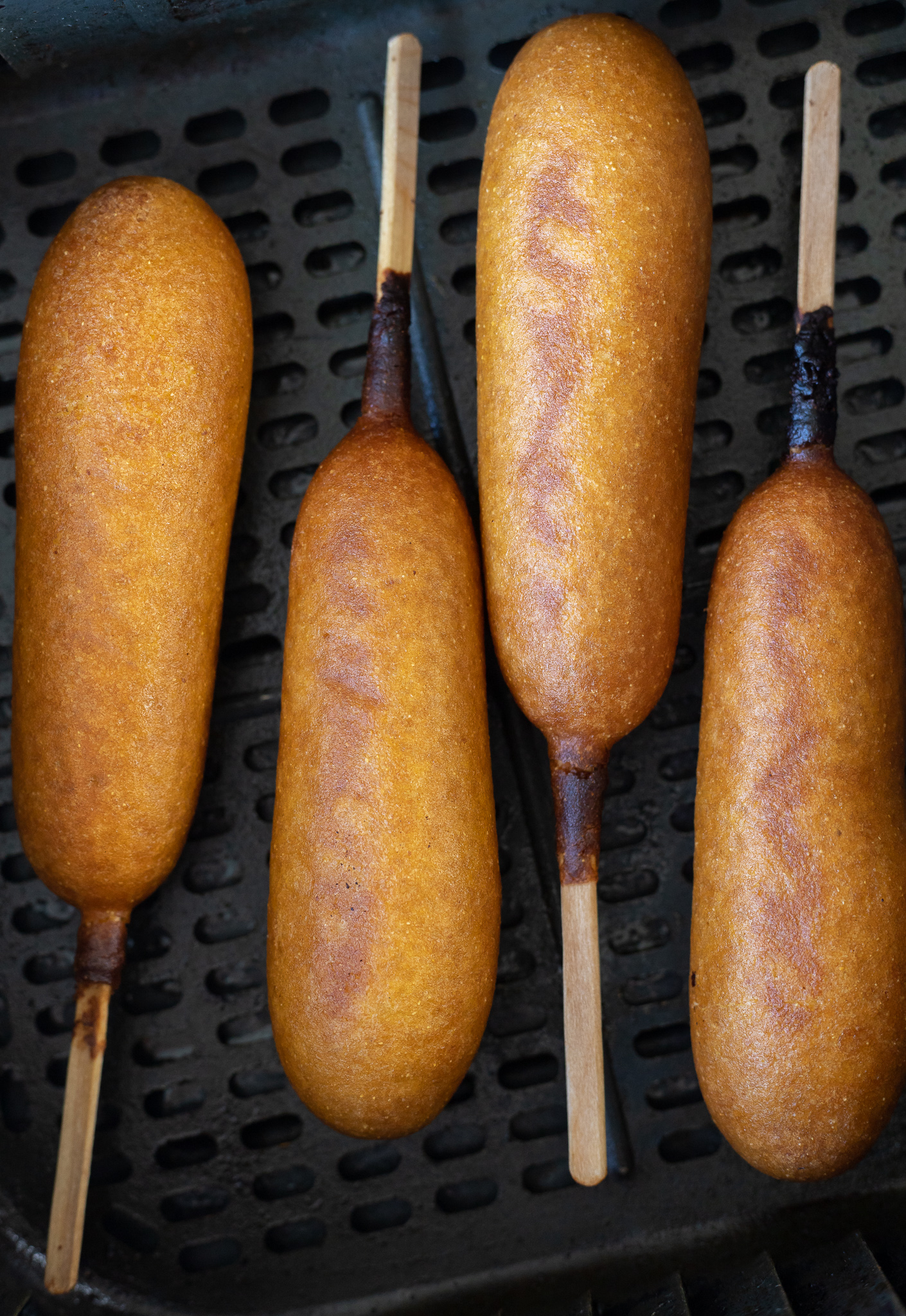 cooked corn dogs in air fryer basket