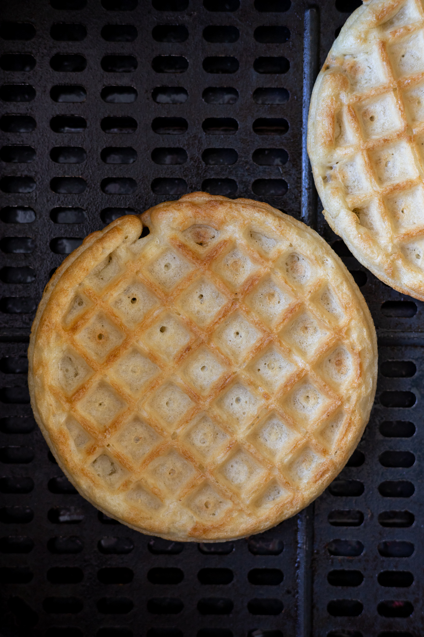 cooked waffles in air fryer basket