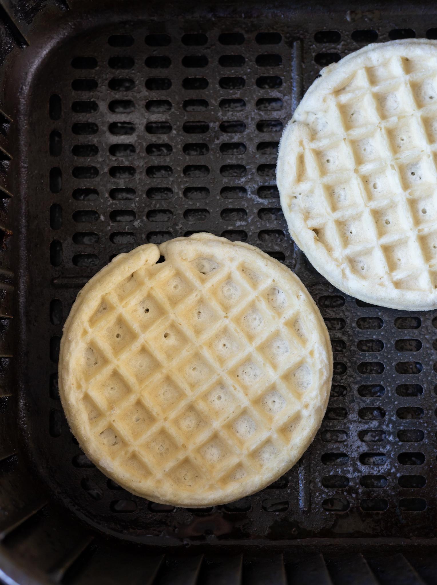 uncooked waffles in air fryer basket