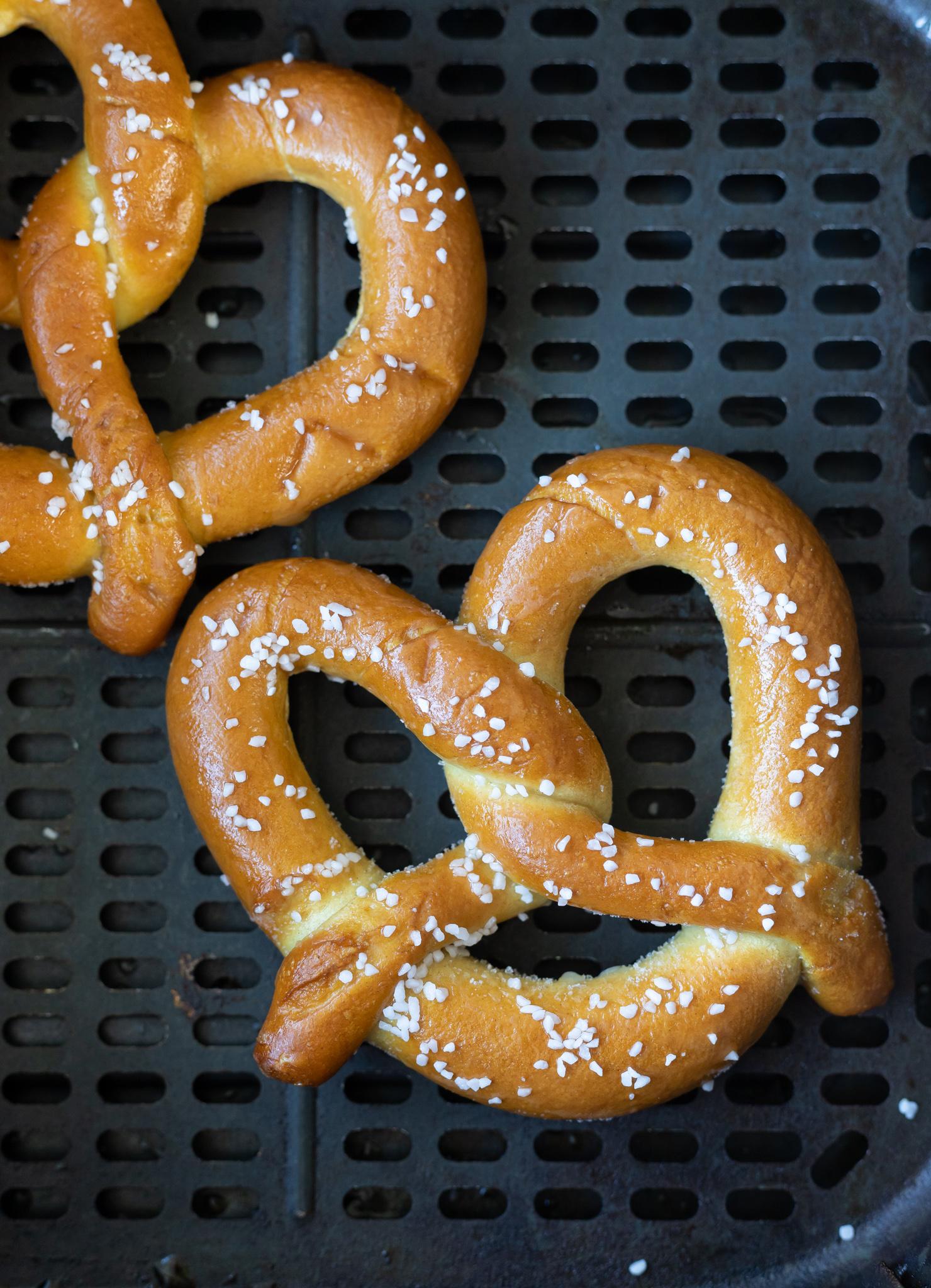 uncooked pretzels in air fryer basket