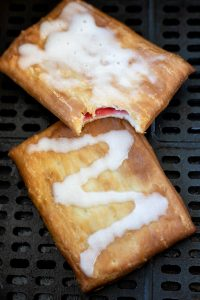 air fryer basket with two toaster strudels